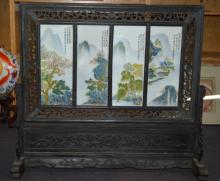Floor screen with 4 porcelain panels, each with a painted river landscape scene, with calligraphy in a carved ebonised timber frame, slotting into matching stand, overall H 88cm, overall W 99cm