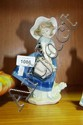 Lladro figurine of a young girl with a basket of
