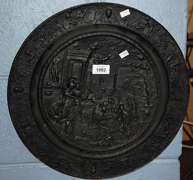 An antique cast iron wall plaque with Roman