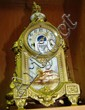 An antique French mantel clock, gilt spelter case