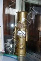 A WWII trench art vase made from a shell casing