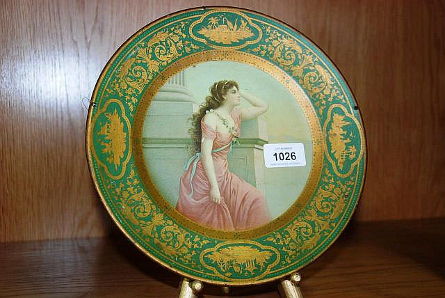 An antique tin display plate with a lithograph
