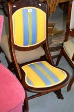 Sedan style rocking chair with blue and white