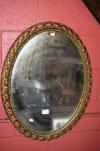 Oval gilded framed wall mirror in good order