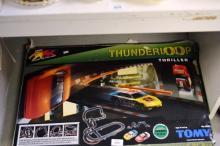 An Aurora AFX Thunderloop track model car