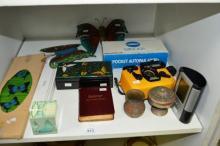 Shelf: cameras, butterfly ornaments, trinket box,