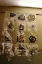 12 British badges incl. Lancers, Camerons,
