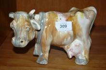 Australian pottery model of a cow with drip glaze