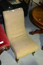 An antique sleigh chair, calico upholstered,