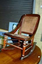 An antique plantation style cedar rocking chair,