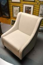 An armchair with neutral modern upholstery, fitted