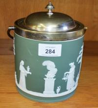 Old Wedgwood Jasperware biscuit barrel, white on sage green with frieze of classical figures, silver plate mounts, swing handle, height of body 13.5cm not including lid
