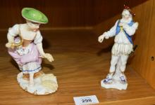 2 European porcelain figurines incl. one of a female wheat cropper with Royal Vienna blue beehive mark to underside, note: major restoration, one of a man standing with an unusual cut out shape hat and sword, tallest is 14.5cm