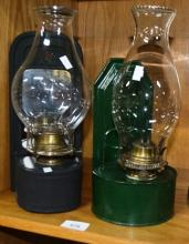2 vintage wall mounted kerosene lamps, each painted tin; 1 green, 1 black and 1 with mirror reflector. Each with glass chimney