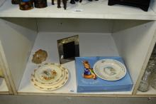 4 x Doulton Bunnykin plates, Wedgwood Peter Rabbit plate and wall clock, silver coloured frame and glass pig moneybox