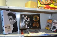 Shelf: musical related items incl. Lim/Ed plaque of Elvis, Beatles cassettes, book etc