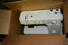 Boxed Janome sewing machine