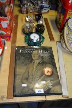 7 glass items incl. swan, paperweight, candle holders, clock, plus book on history of Pennant Hills