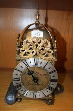 18th Century style brass lantern clock, nice example, mechanical movement, single lead weight complete with pendulum and original singtle hand, brass face engraved: Tho. Moore, Ipswich fitted with brass bell to top housing, note: should be mounted to a w