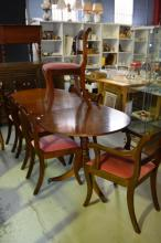 Regency style dining suite comprising of an oval extension dining table with 1 leaf and 8 dining chairs (6 chairs and 2 carvers) all upholstered in a blush/crimson fabric. Table is 216 x 88cm (fully extended)