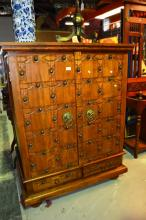 Large carved teak entertainment cabinet with studded detail to door, 110cm W