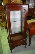 Mahogany display cabinet, single glazed door with interior adjustable glass shelving, silk backboard, base fitted with single drawer, on cabriole legs, comes with key, 134cm T x 54cm W