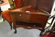 Unusual corner cabinet, serpentine shaped with claw and ball feet with hinged lid to top, and open shelf under. 60cm T