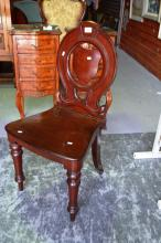 Antique mahogany hall chair with carved shield style back, original maker's label to underside 'Alfred Speight, cabinet maker, bottom of Manchester Road, Bradford' 90cm H