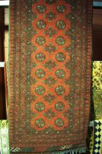 Afghan hand knotted, pure wool runner, geometric design with red ground, 280 x 76cm