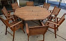 Octagonal hard wood slatted outdoor table with a