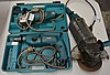 2 x Makita power tools including a small angle