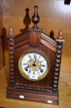 Antique American shelf clock by Ansonia with gothic style timber case, fancy dial, comes with key & pendulum, 42cm tall