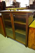 Vintage bookcase with a pair of glazed doors with