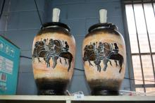 Pair of large painted terracotta table lamps