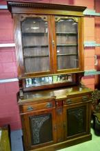 Large carved walnut double height bookcase,