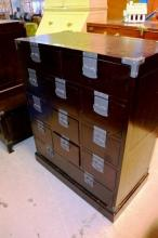 An Oriental chest of 13 drawers, dark stained