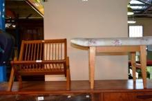 2 items: Boomerang shaped magazine rack and wave