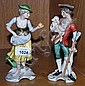 A pair of Goebel figurines dated 1969 of a couple,