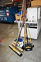 Collection of yard brushes and brooms etc