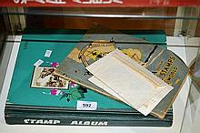 Large turquoise stamp album containing assorted
