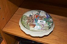 Chinese lidded ceramic dish with figures to the
