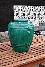 Large green glazed pottery urn, possibly olive