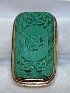 Silver ring with rectangular green carved stone,