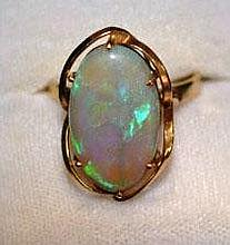 9ct gold ring set with solid opal stone, green &