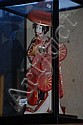Japanese geisha doll in glass display cabinet