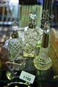 A collection of 3 various cut glass perfume
