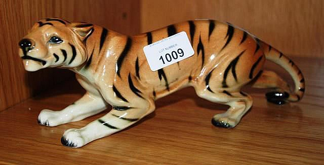 A West German porcelain figure of a prowling tiger