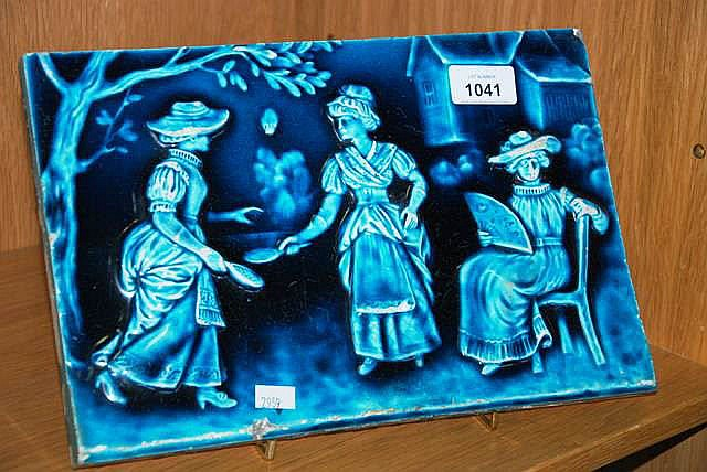 A large antique blue glazed tile embossed design