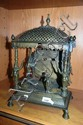 An antique cast brass South Asian shrine with 4