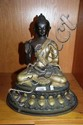 An Asian cast bronze sitting Buddha with